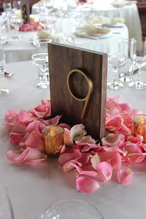 wood and gold table numbers