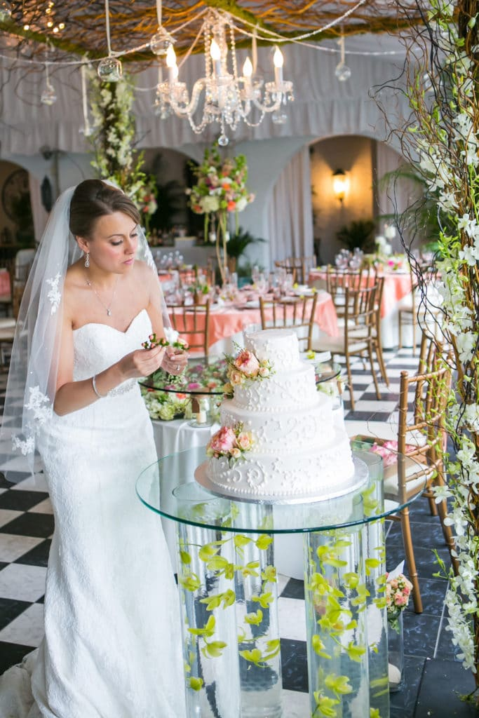 chelsea mansion bride decorating cake with flowers