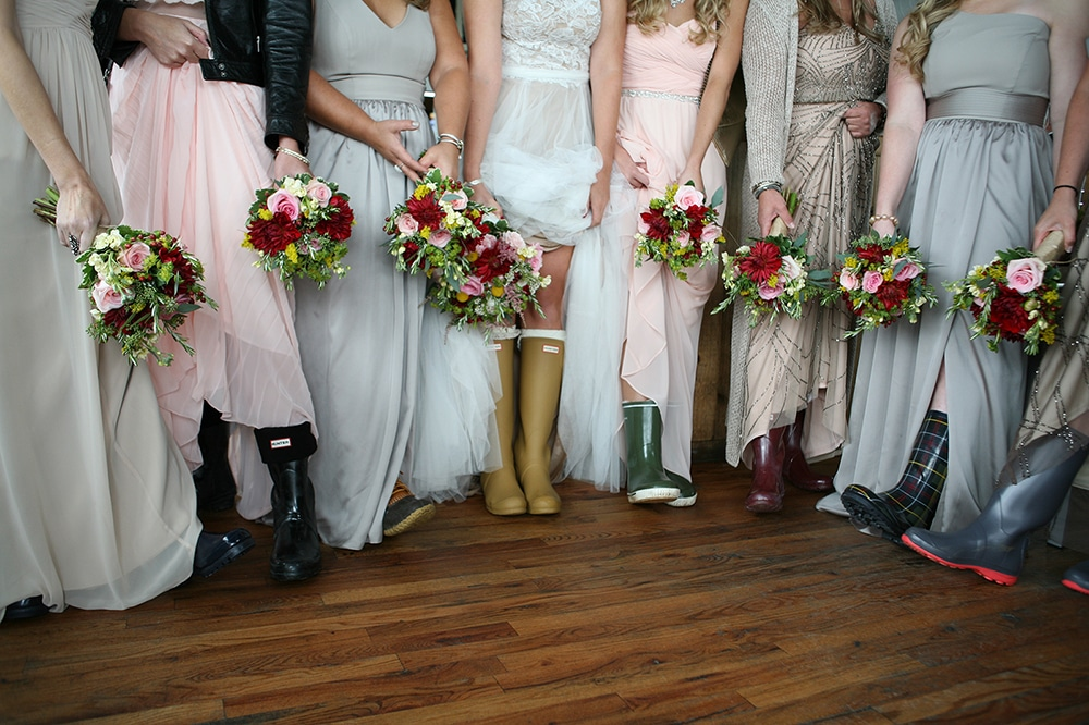 bride bridesmaids bouquets and rain boots, bouquets of astilbe, roses, dahlias, billy balls