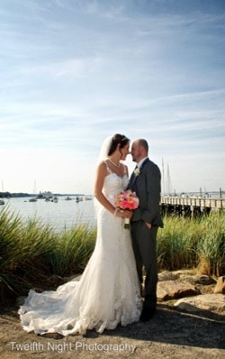 bride and groom beachside with bouquet
