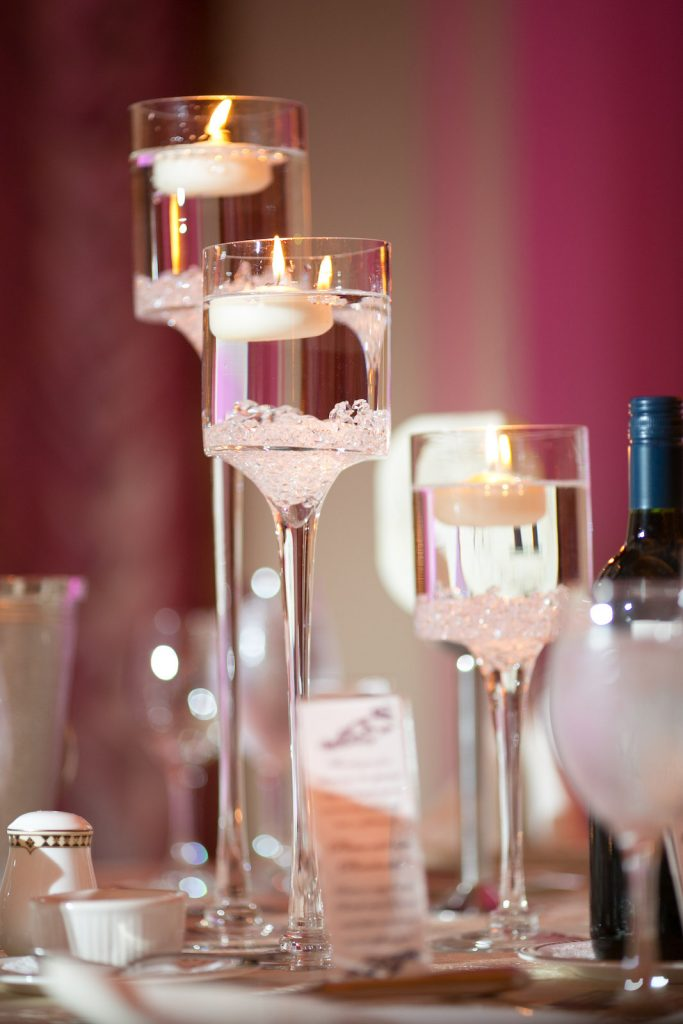 low centerpiece, large stemmed glass candle holders, candle holders, the larkfield, mini calla lilies, floating candles, small diamond gems