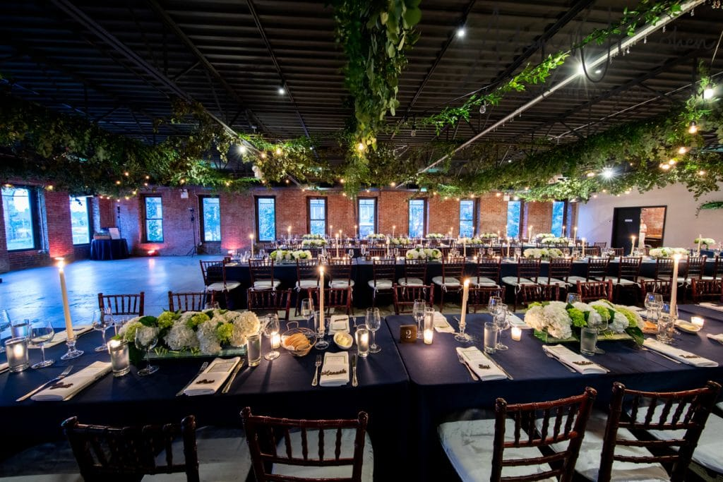 gantry loft long island city table centerpieces, green and white centerpiece, long island wedding flowers, nyc wedding flowers, navy wedding, green wedding, white wedding, ceiling flower treatment, hanging wedding lights, chic a floral boutique, wedding flowers, long island wedding florist, hydrangeas, rectangular vase