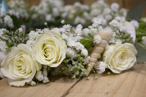 Close up of floral crown with spray roses baby's breathe and seashells, long island wedding flowers