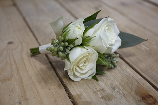 white spray rose boutonniere, boutonniere, long island wedding flowers, groom boutonniere, groomsmen boutonniere, seeded eucalyptus