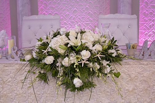 bride and groom table, orchis, roses, hydrangea, bear grass, lilies, starfish, beach themed wedding, marina del rey