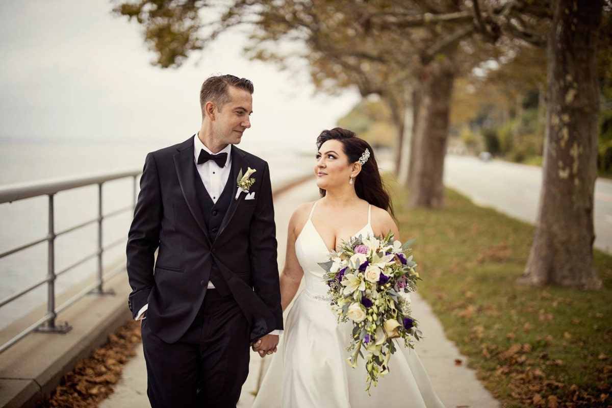 cascading bouquet of calla lilies, roses, hypericum in white, ivory and purples, long island wedding flowers, sea cliff manor wedding, bridal bouquet, groom boutonniere, calla lily boutonniere, anchor and lace photography, husband and wife