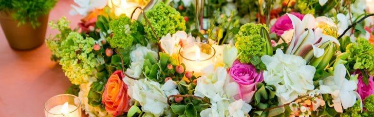 low colorful centerpiece, bright color centerpiece, viburnum, roses, hydrangeas, orchids, lilies, candles, chelsea mansion